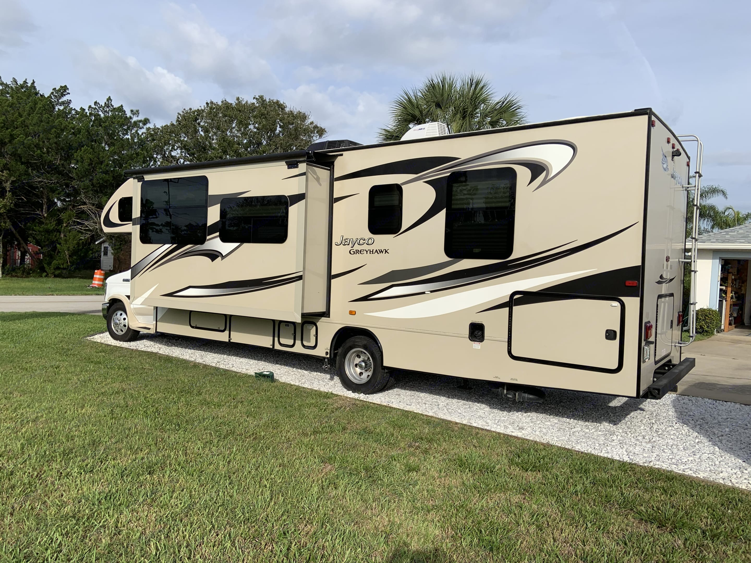 Exterior Curbside with extended slideout. Jayco Greyhawk 2016