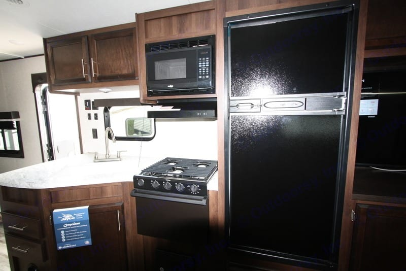 Kitchen with double sink, stove top, stove and nice fridge. . Jayco Jay Flight 2020