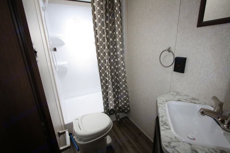 Bathroom with stand up shower, toilet and sink. Jayco Jay Flight 2020