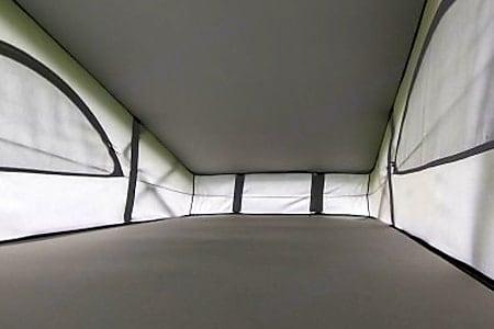The 'secret' bed in the pop up roof has plenty of room for 2 adults. Volkswagen Jobl Kampa 2018