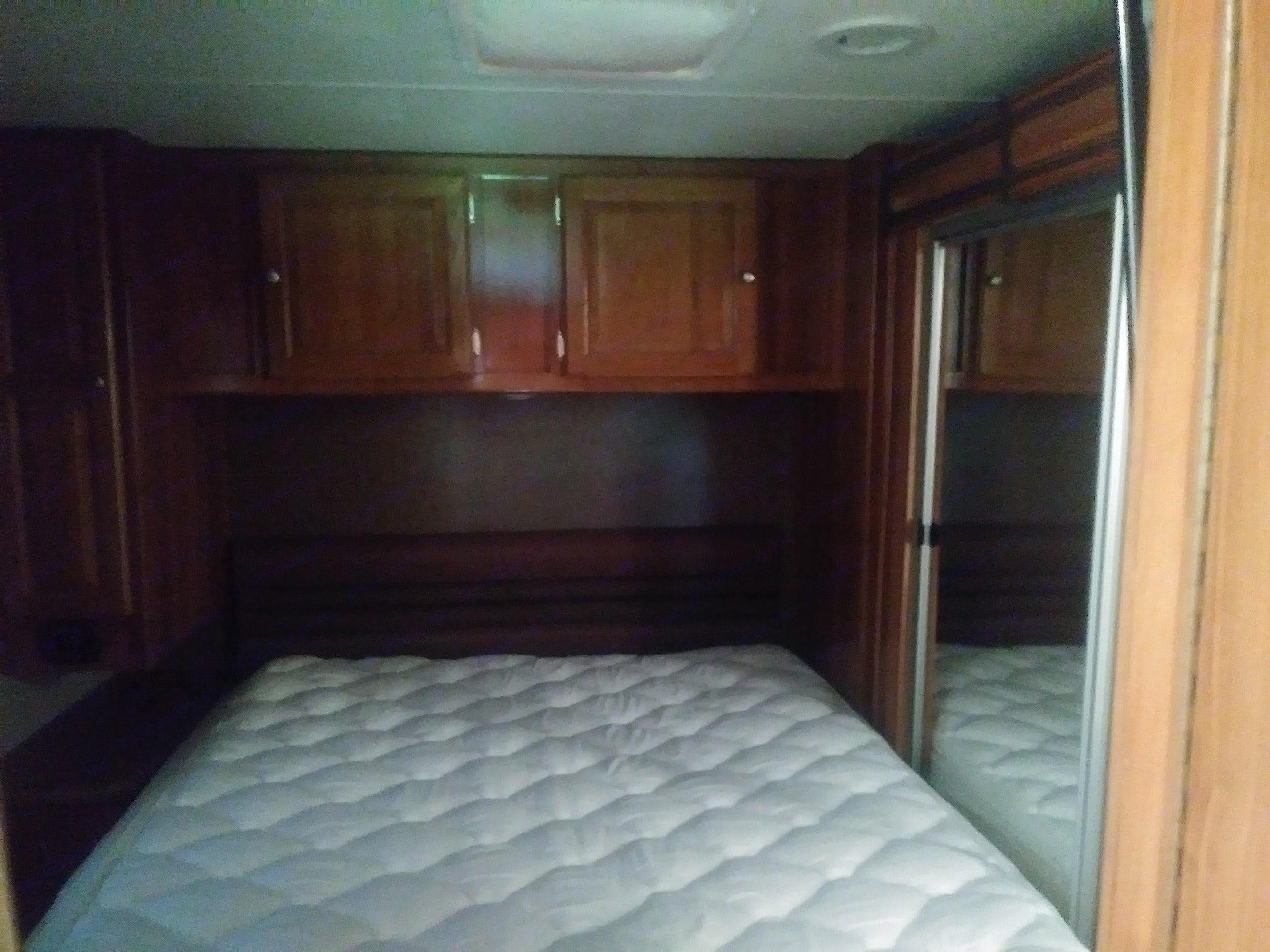 Private Master bedroom with door.  . Coachmen Leprechaun 2018