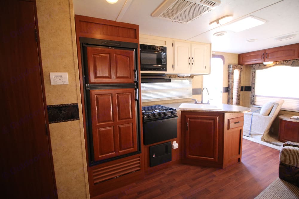 Refrigerator, freezer, stove, microwave, sink. Storage! You will be provided with dishes, cups, utensils, pots/pans. Keystone Outback 2011