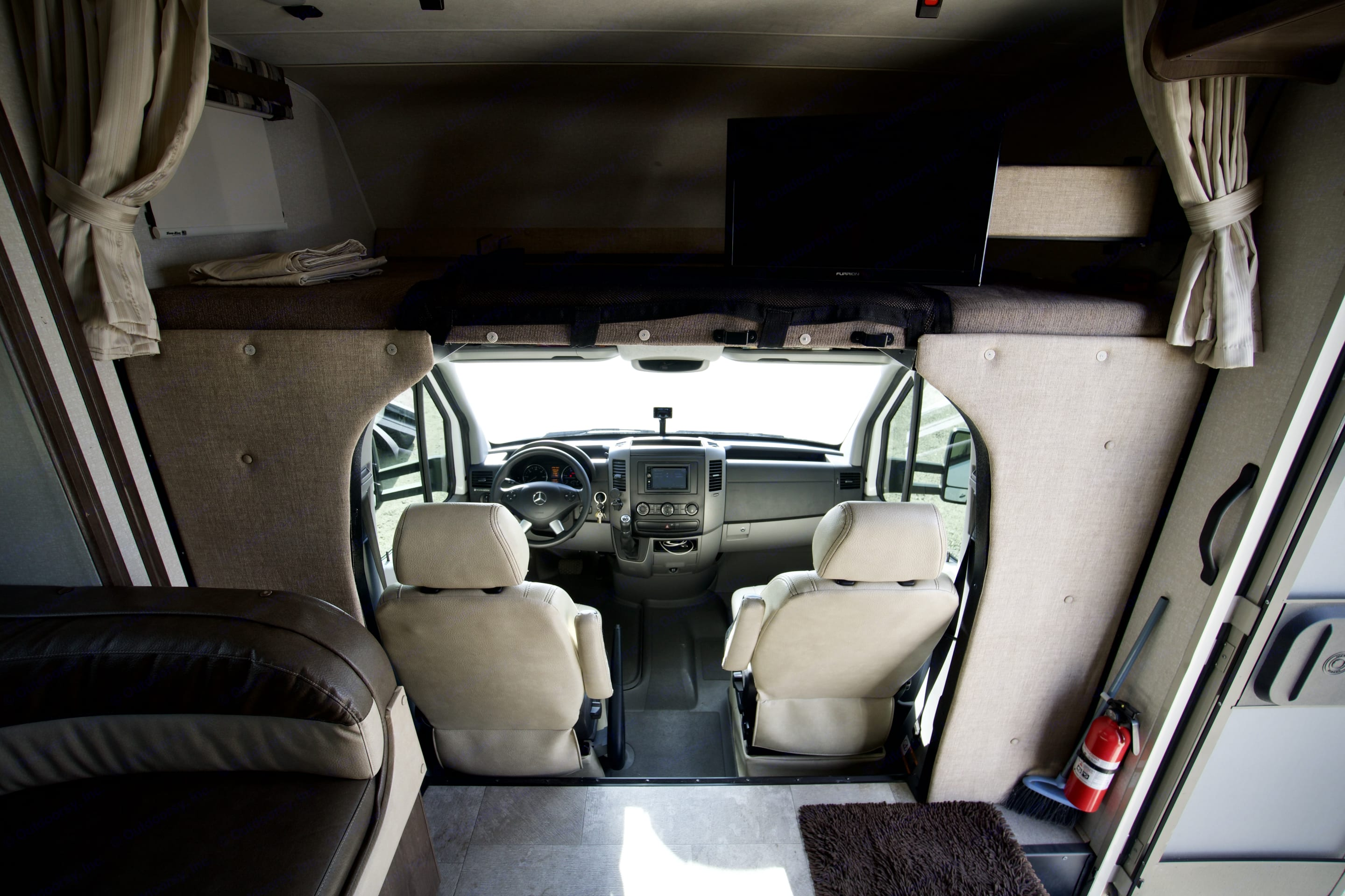 A view out the front. Both driver and passenger seats have the ability to swivel around to add more seating while parked.. Coachmen Prism 2018
