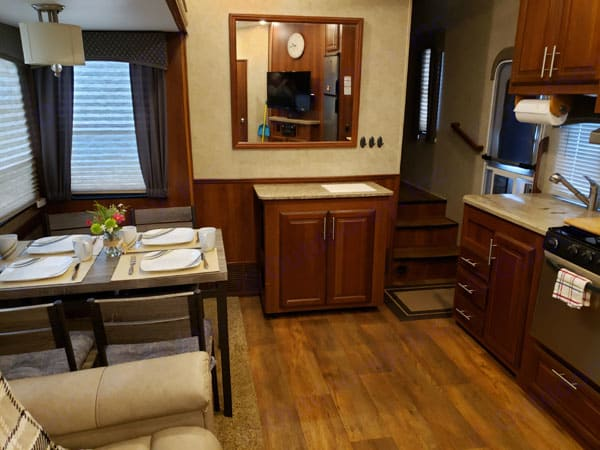 looking from Bunk house into living room / kitchen with a  movable island. Forest River Wildcat 2015