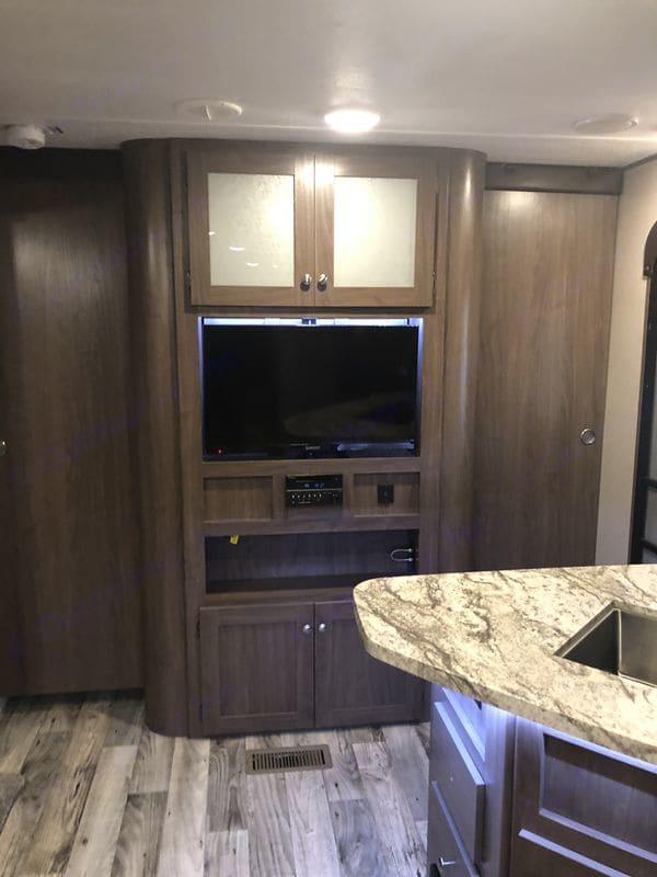 Doors close off master bedroom and TV swivels. Keystone Hideout 2018