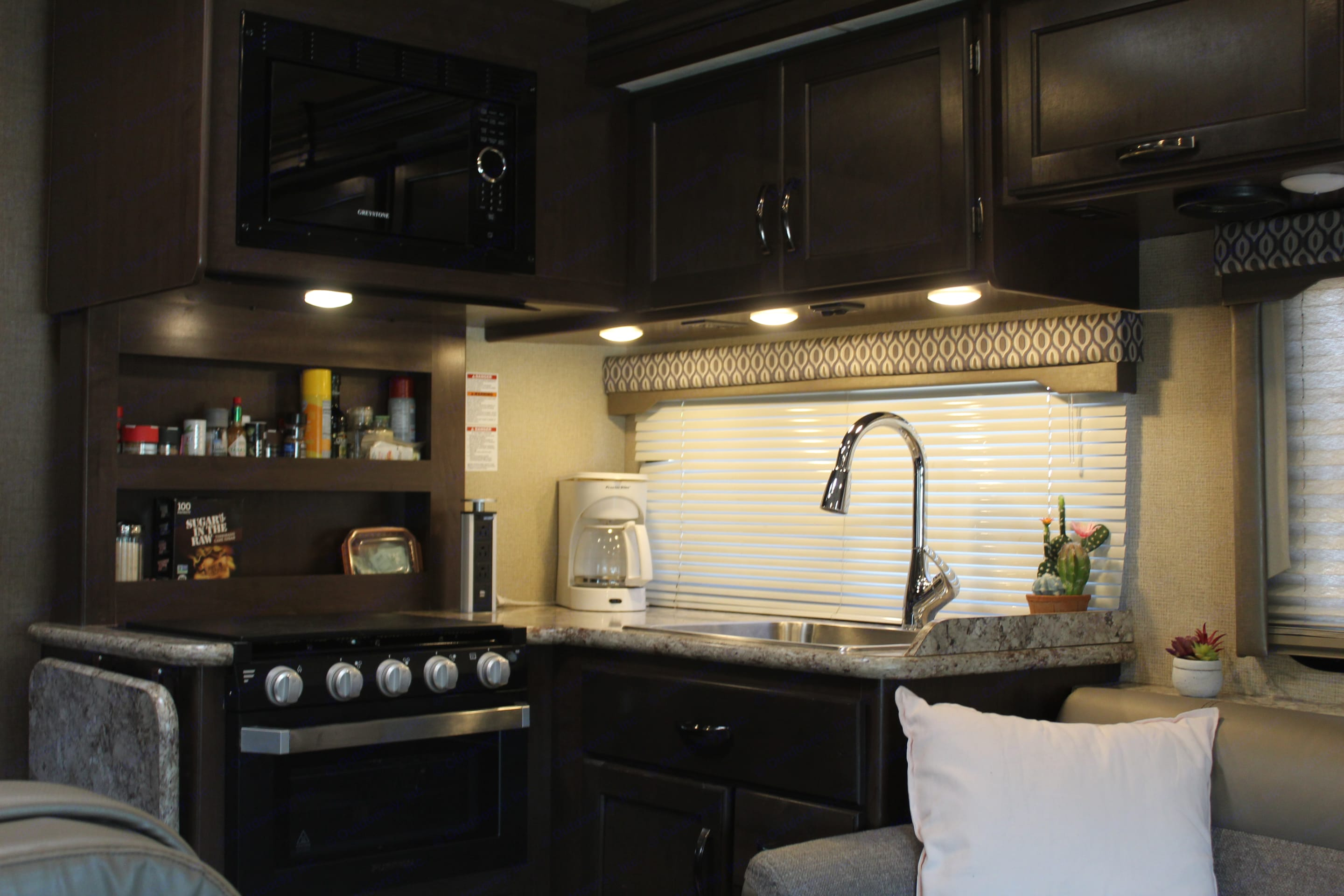 Stocked kitchen with coffee maker, toaster, and blender . Thor Motor Coach Freedom Elite 30FE 2019
