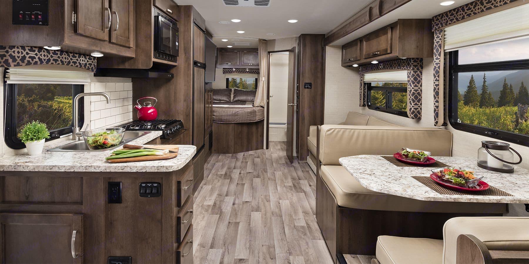 Full kitchen and bathroom areas.. Jayco Redhawk 2019