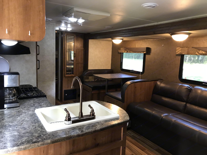 Open Floorplan with kitchen dining and couch. Gulf Stream Amerilite 2016