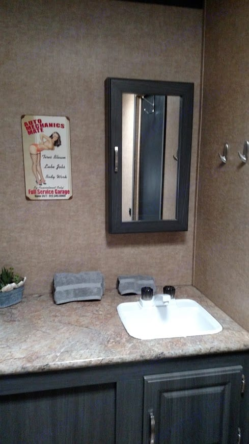 Spacious bathroom - stand up shower and wardrobe closet . Forest River Work And Play 2014