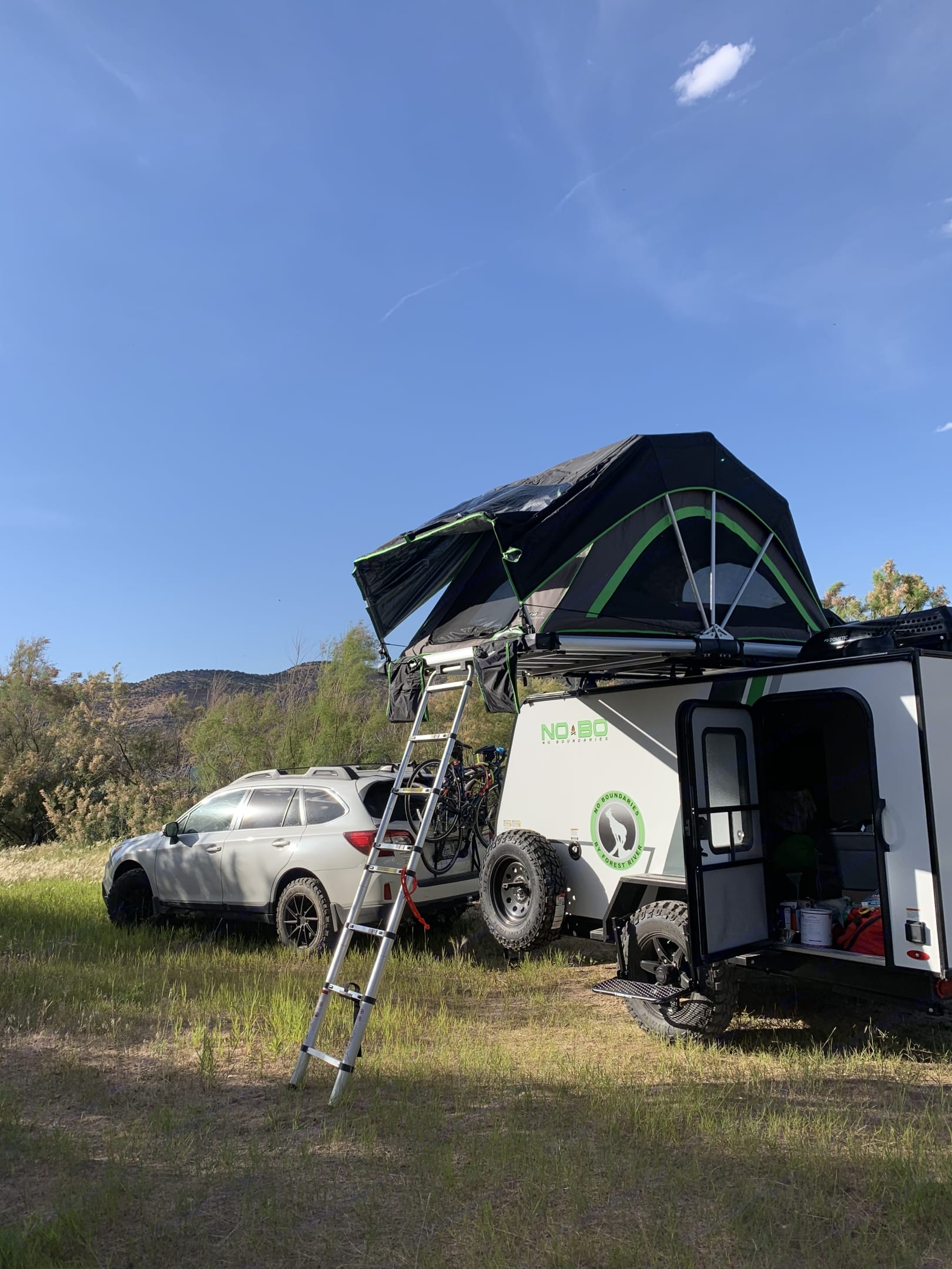 Exterior with tent set up in the wild. sleeps 2 comfortably, can fit 3 adults up top, 2-3 in camper. Forest River Other 2020