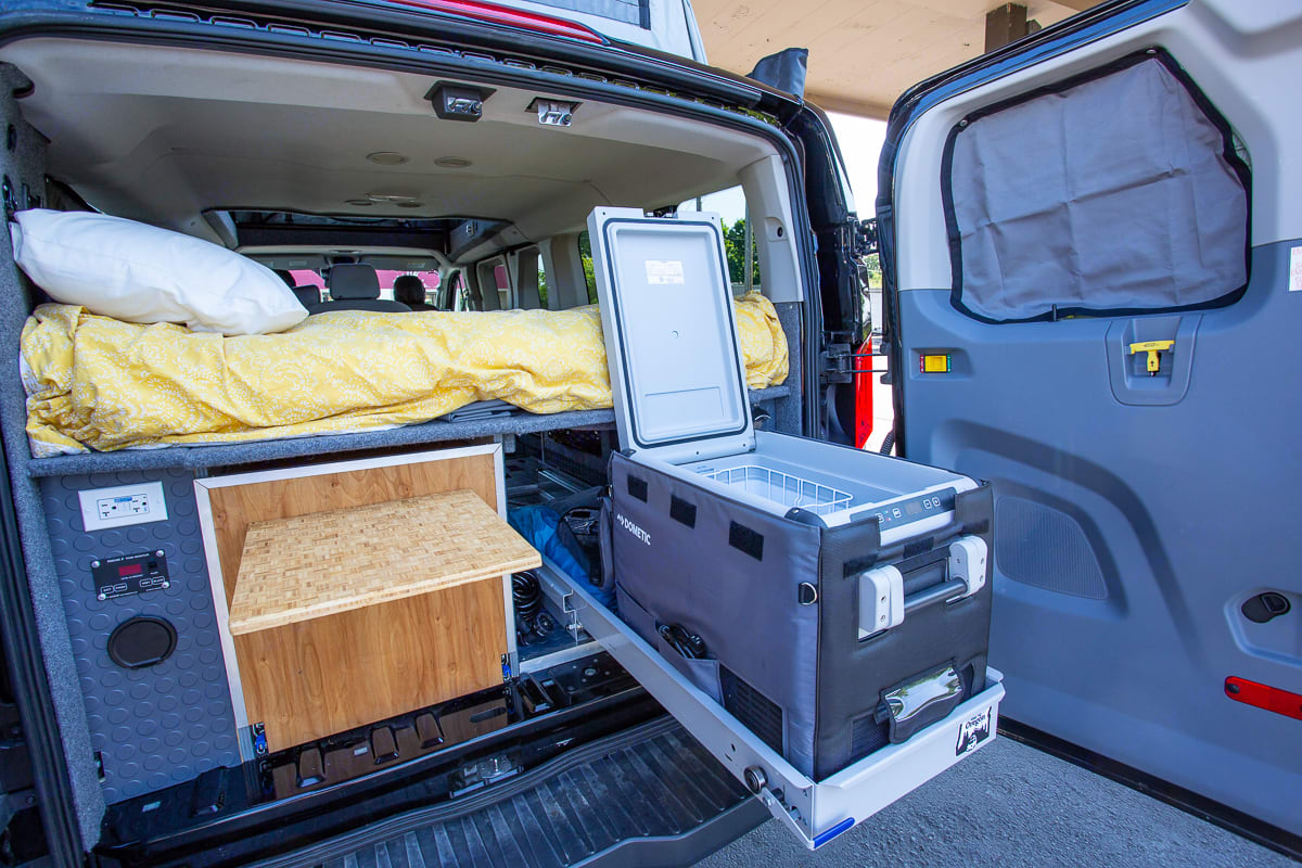 The 12v dometic fridge/freezer doesn't require ice and is DC powered by the aux battery . Ford F350 2018