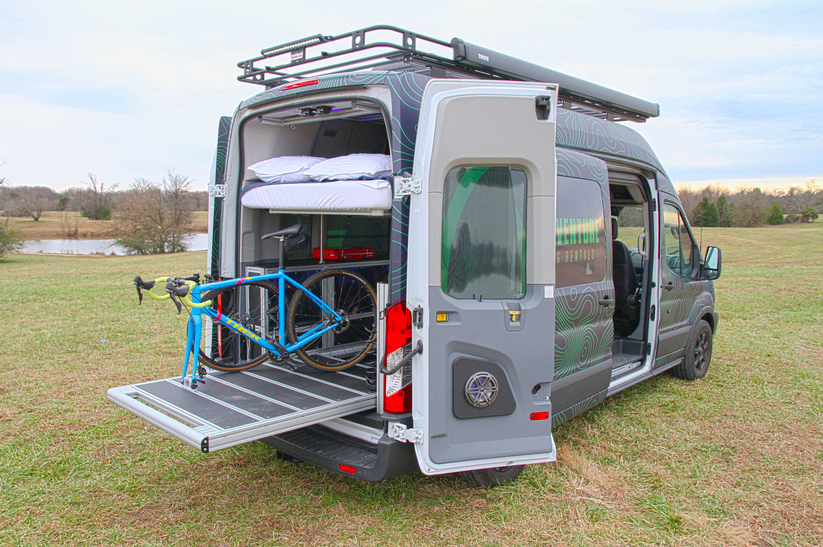 Large roof rack for gear. Extending gear slide for easy packing and accessing. That slide can also be used as a bed. Telescoping queen bed goes up and down depending on whether you need more sleep space or gear space. . Ford Transit Custom 2017