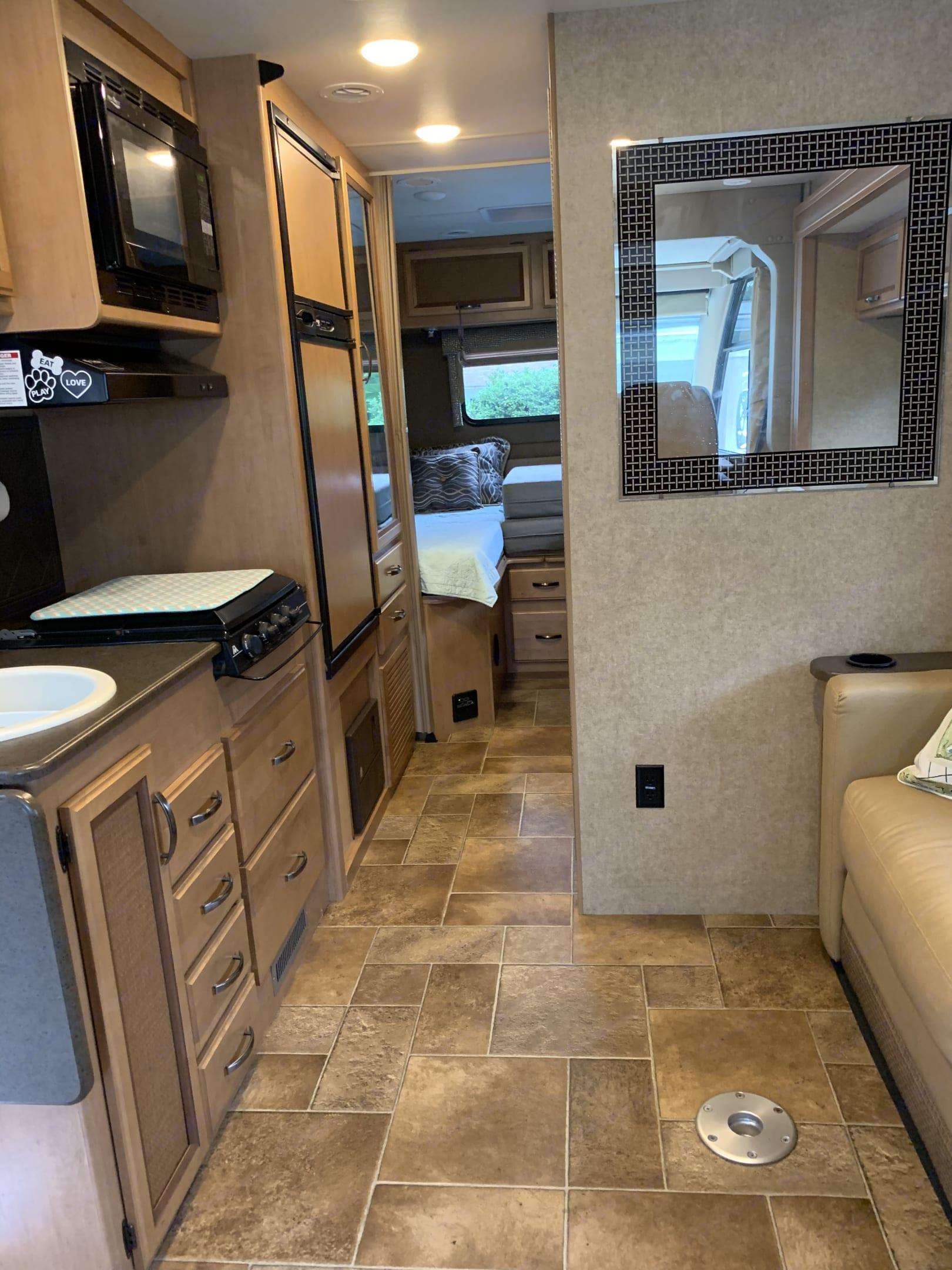 Kitchen area looking down hall towards bedroom. Thor Motor Coach Vegas 2016