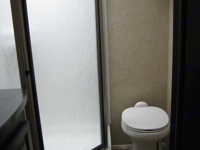 Bathroom with stand up corner shower . Forest River Viper 2012