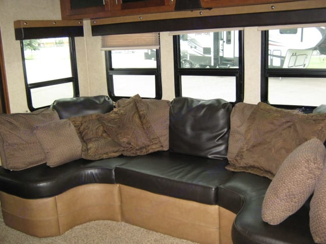 Living room. Concerts to dinning room with a table.. Forest River Viper 2012