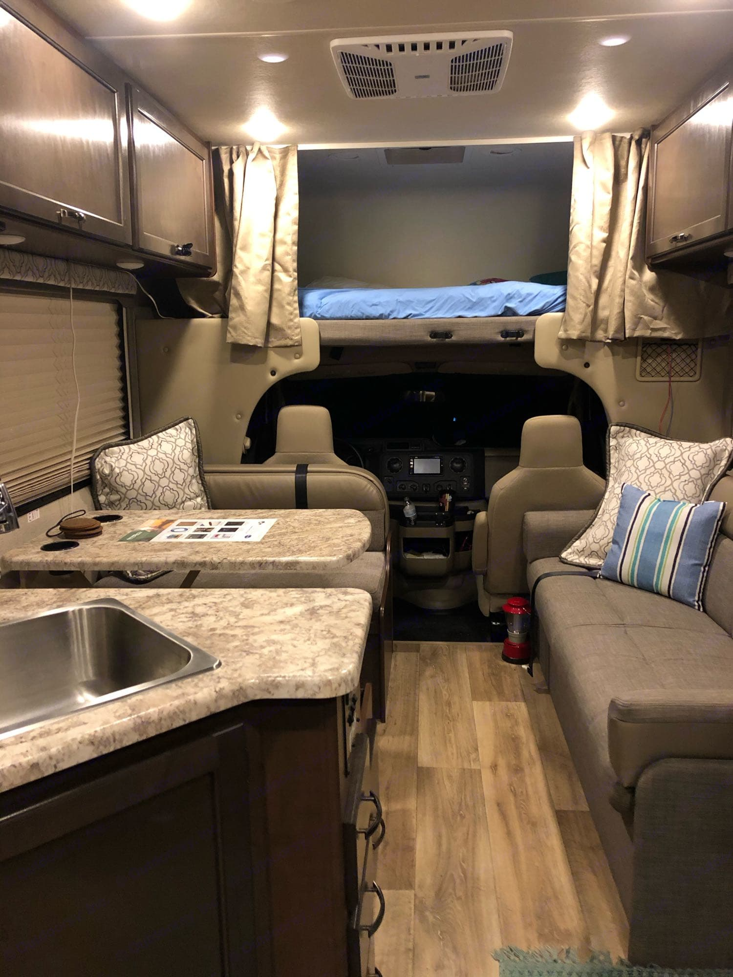 over cab bunk full size, fold down couch, and table makes a bed, full size sink. Ford Fourwinds 2020