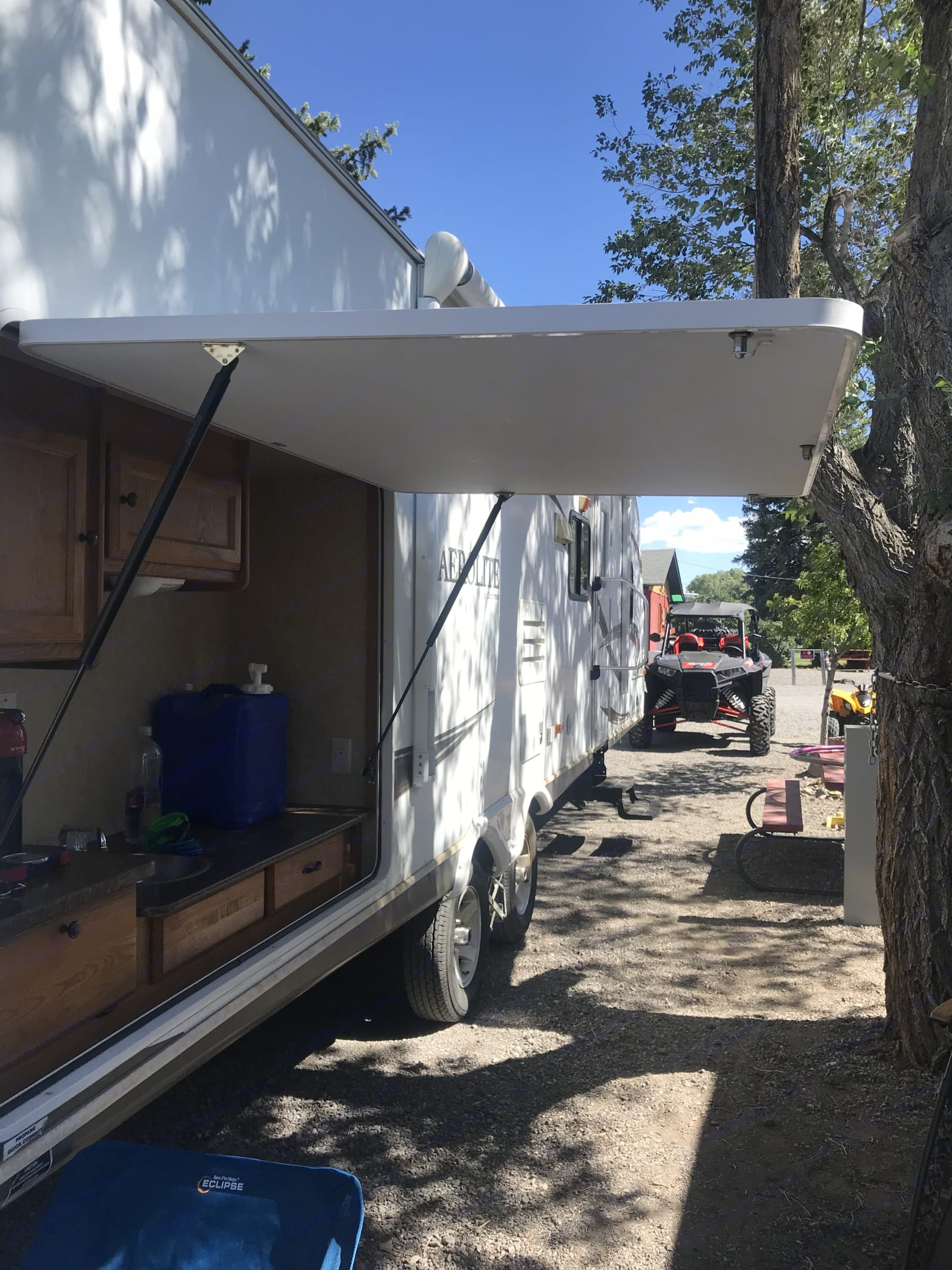 Has outside counter, stove and storage. Aerolite Travel Trailer 2010