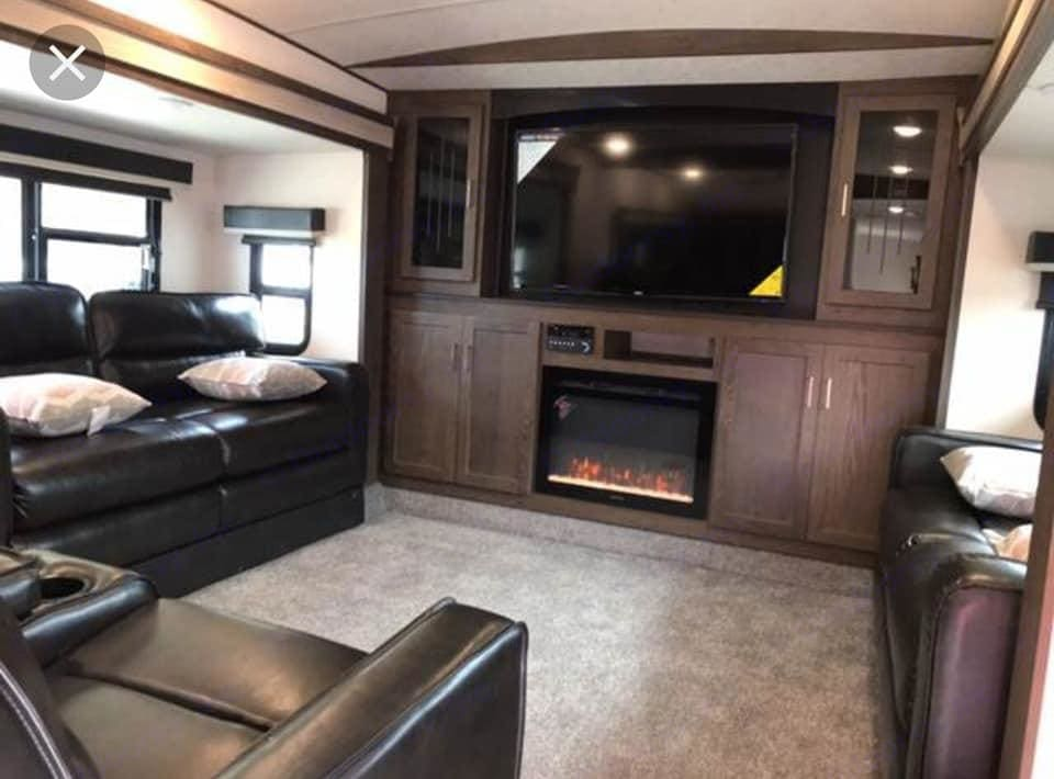 Living Room with 2 Pull out couches and 2 Theatre Reclining Seats. Forest River Hemisphere 2018