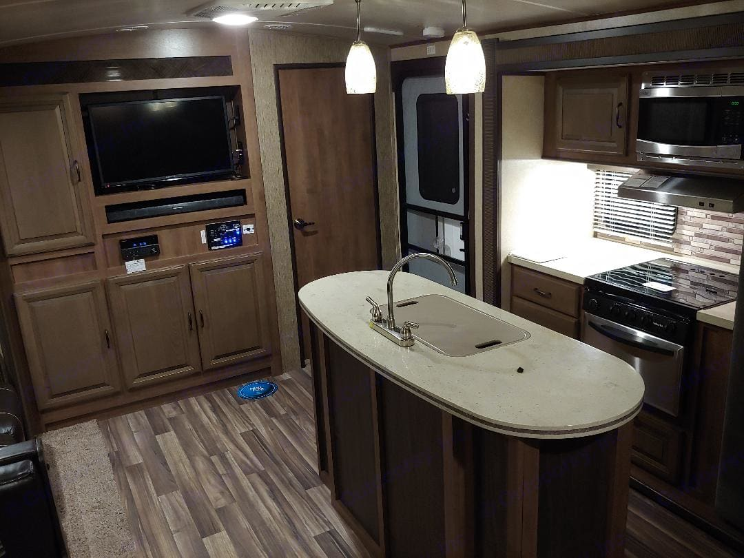 Spacious living area with kitchen island for extra counter space. Cruiser Rv Corp Fun Finder 2017