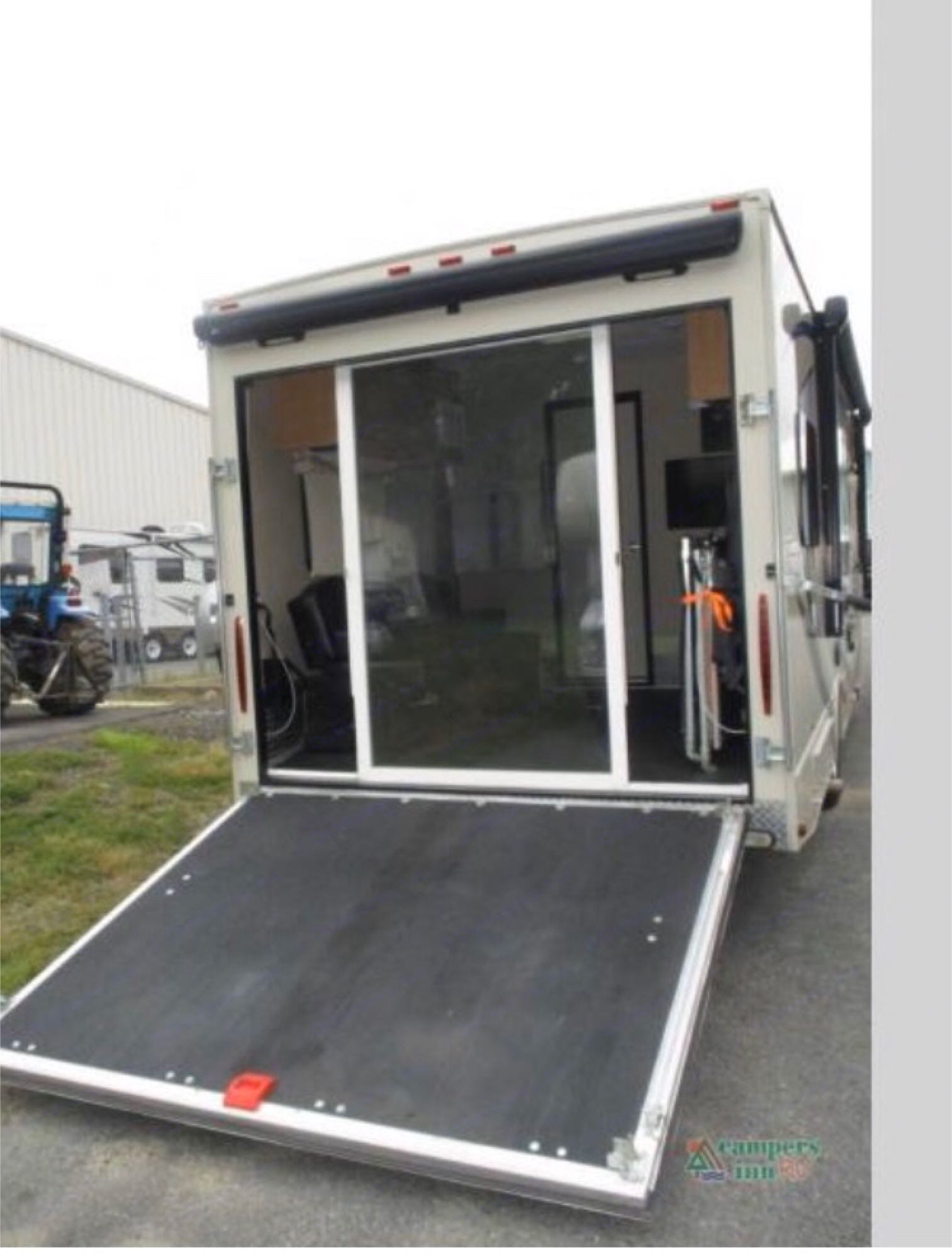 ramp into the toy hauler area, this ramp easily converts to a deck. The exterior light, awning and sliding lexan doors make for a relaxing space. Thor Motor Coach Outlaw toy hauler 2017