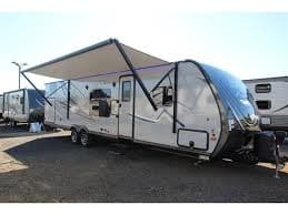 Electric roll out awning wit speakers and lighting . Coachmen Apex 2017