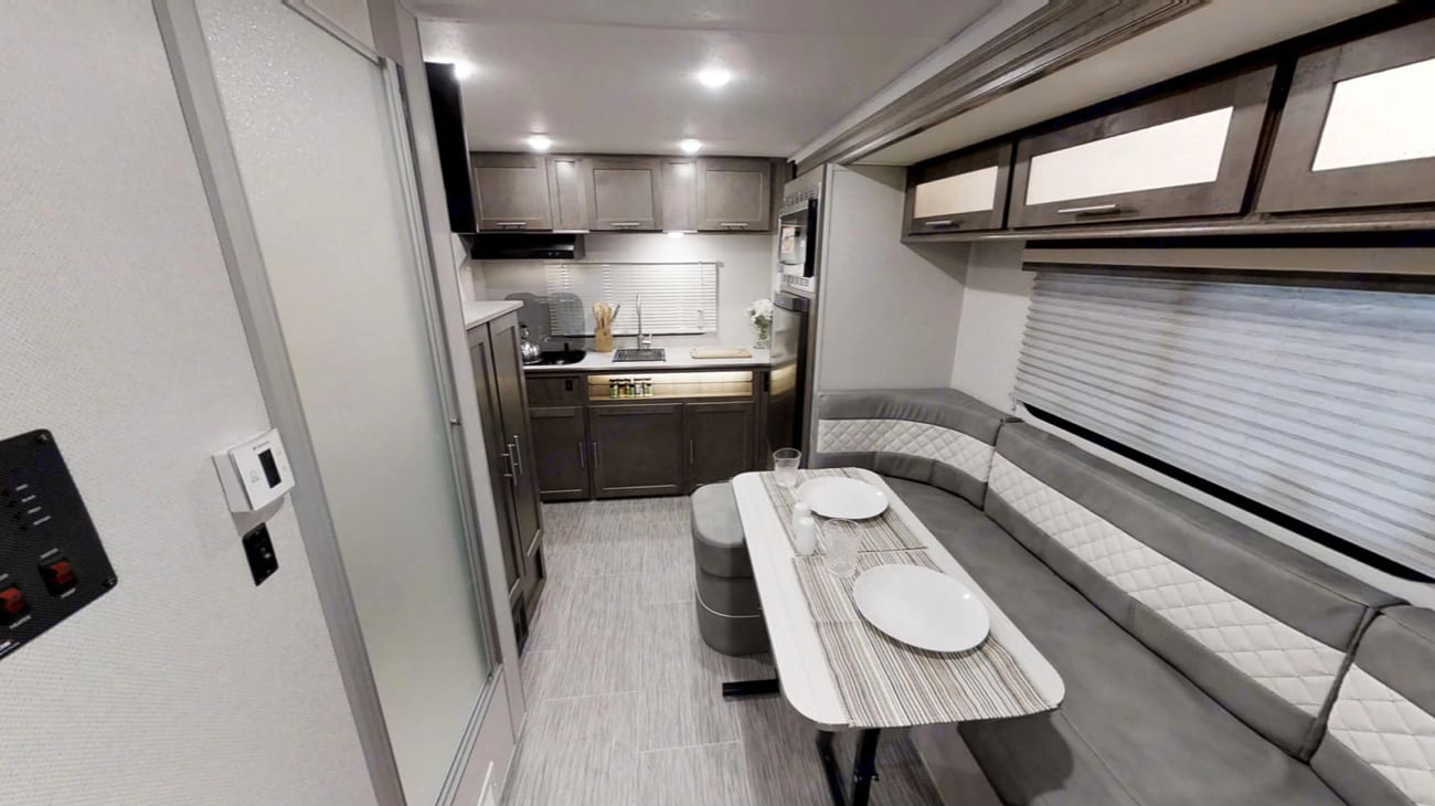 Dining table seats 4.  *These are stock photos...our camper has brown leather (not gray), but everything else is the exact same. Updated pictures coming soon.. Forest River No Boundaries 16.7 2019