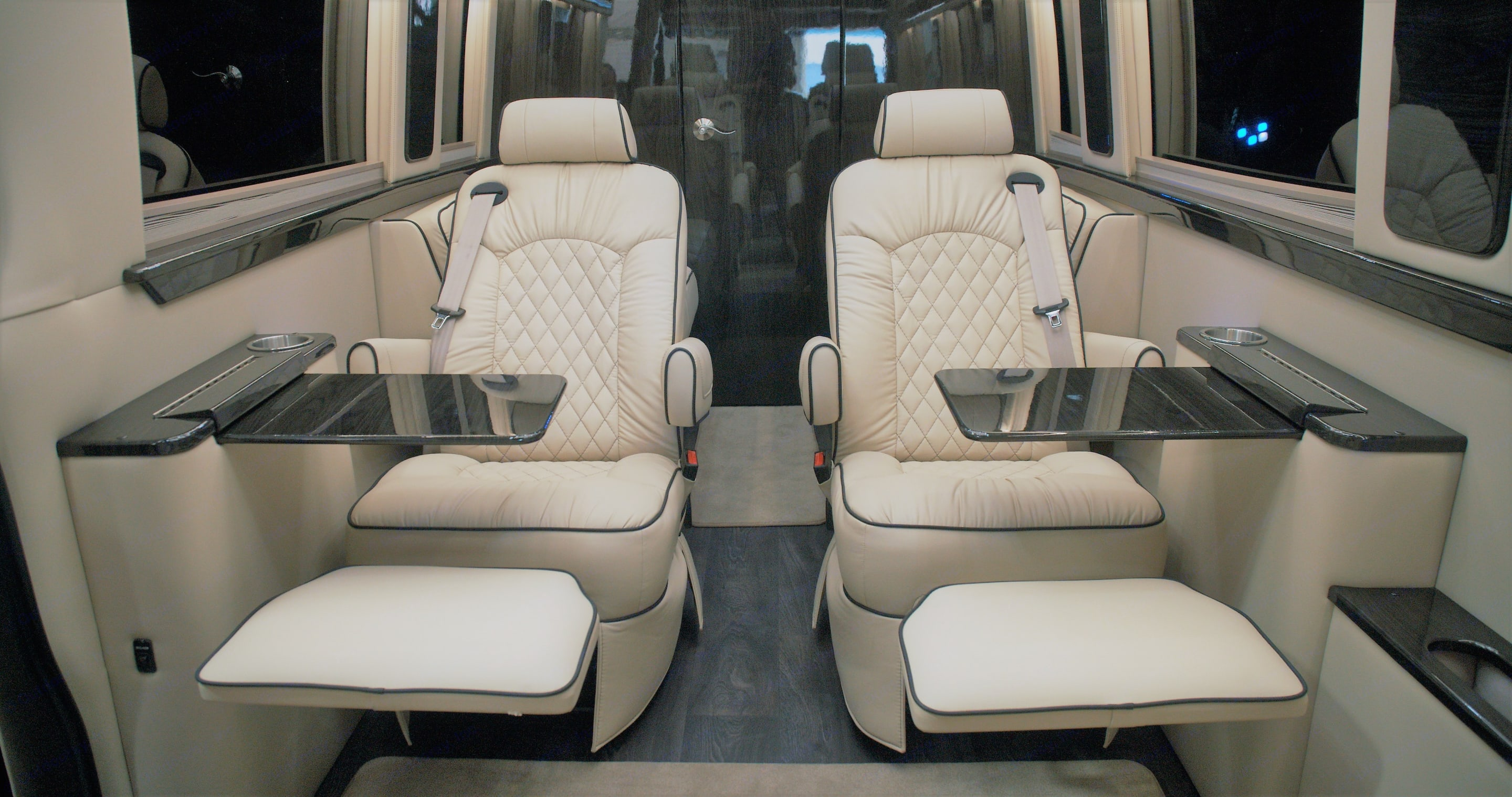 Convenient pull out tables and foot rests.. Mercedes Sprinter 2020