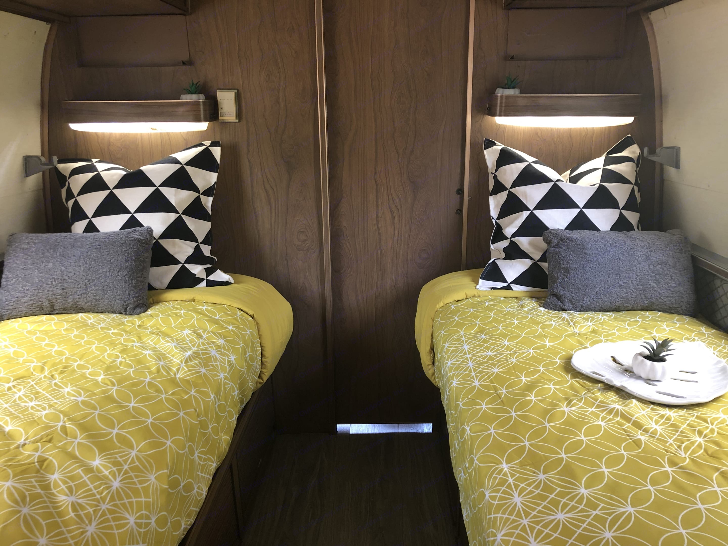 Two private twin beds with memory foam toppers and provided linens. Airstream Land Yacht 1972
