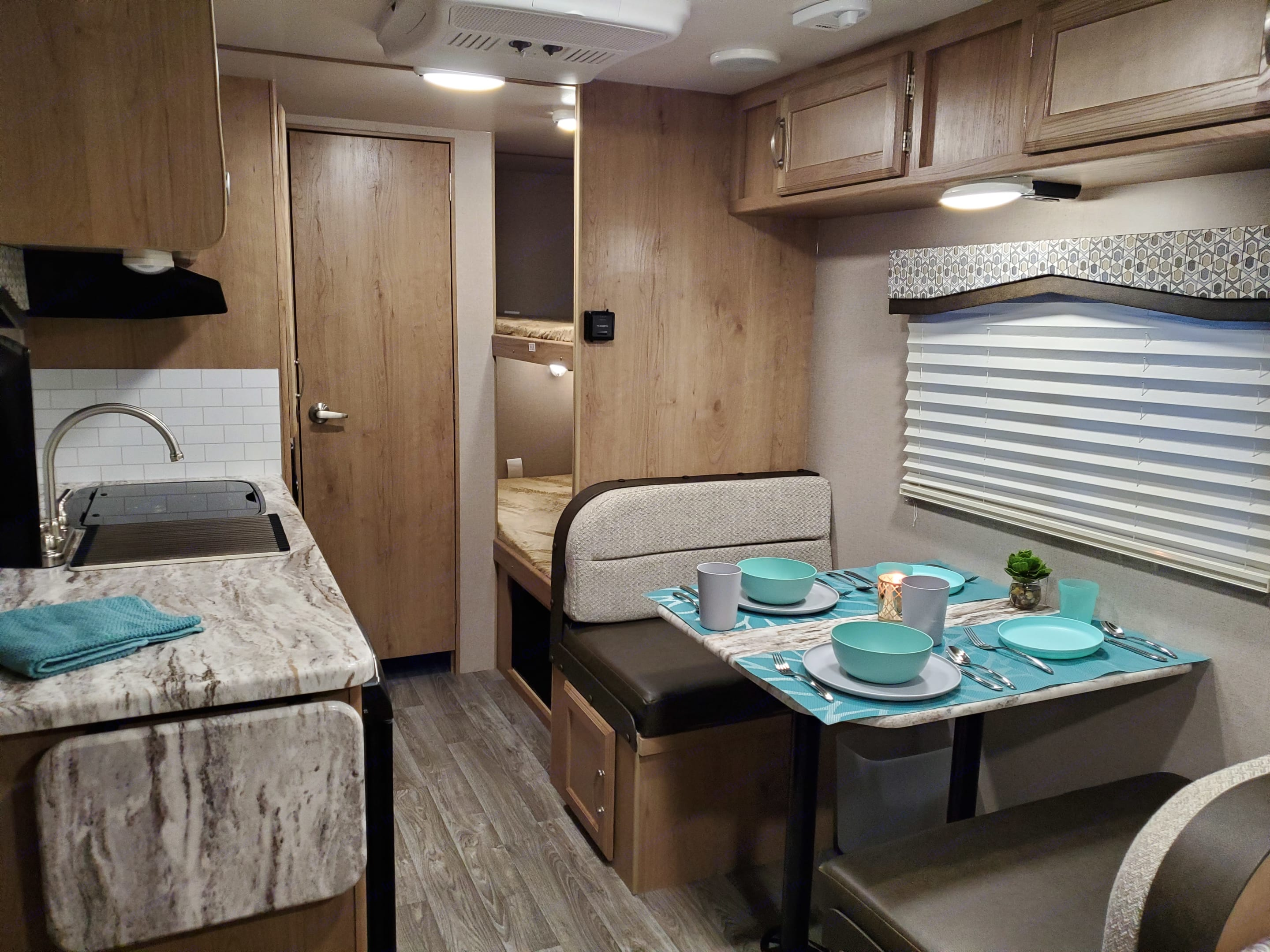 Table makes down to a bed for a child.. Winnebago Micro Minnie 2020