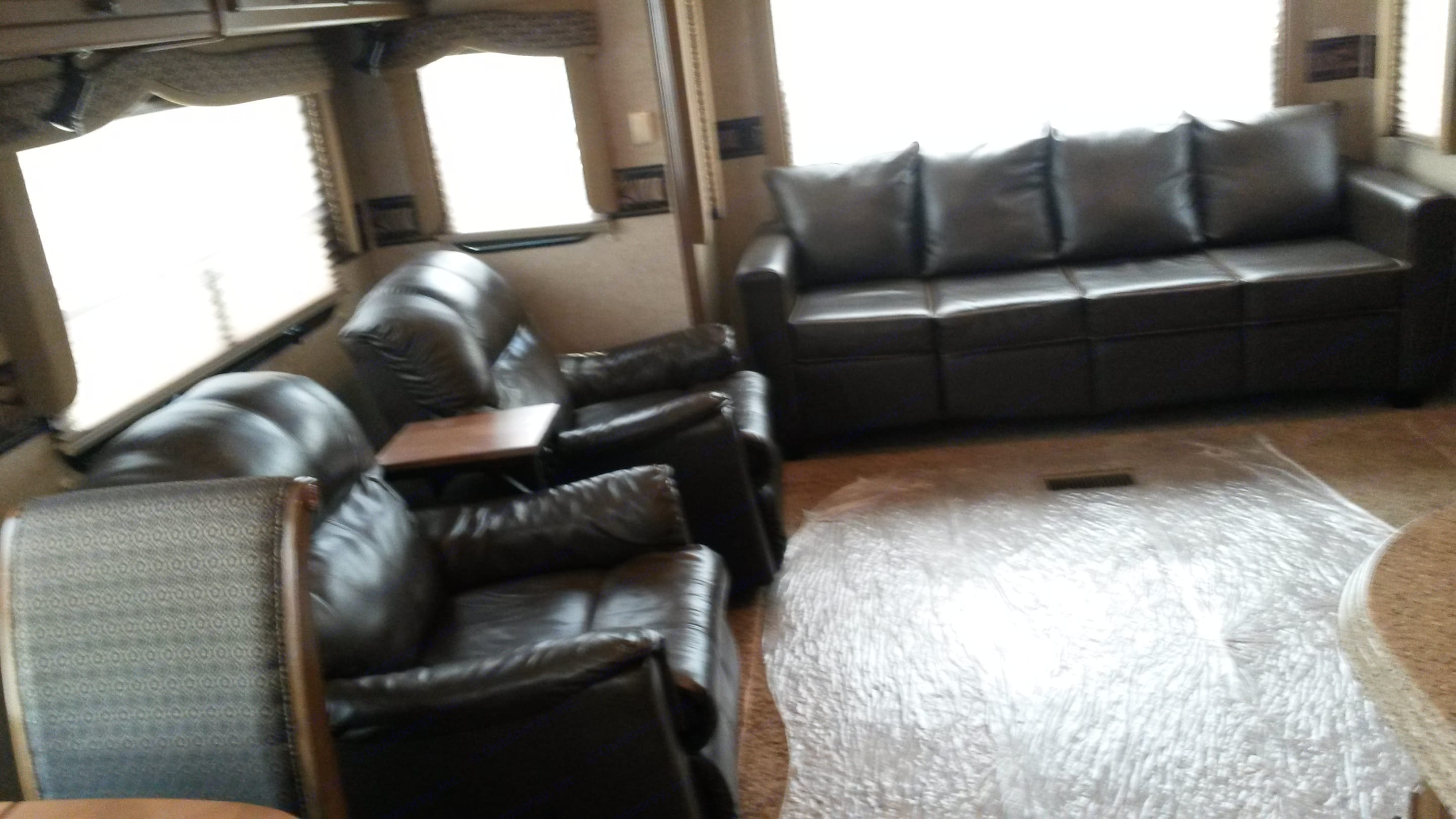 Living room with couch that makes a queen bed.  The recliners are no longer there.  I will put another small loveseat or chairs in that spot soon. Heartland Landmark 2012