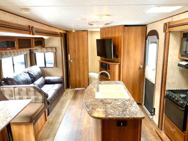 Island Kitchen Sink and Living Area with tv. Prime Time Avenger Touring Edition 32BIT 2015