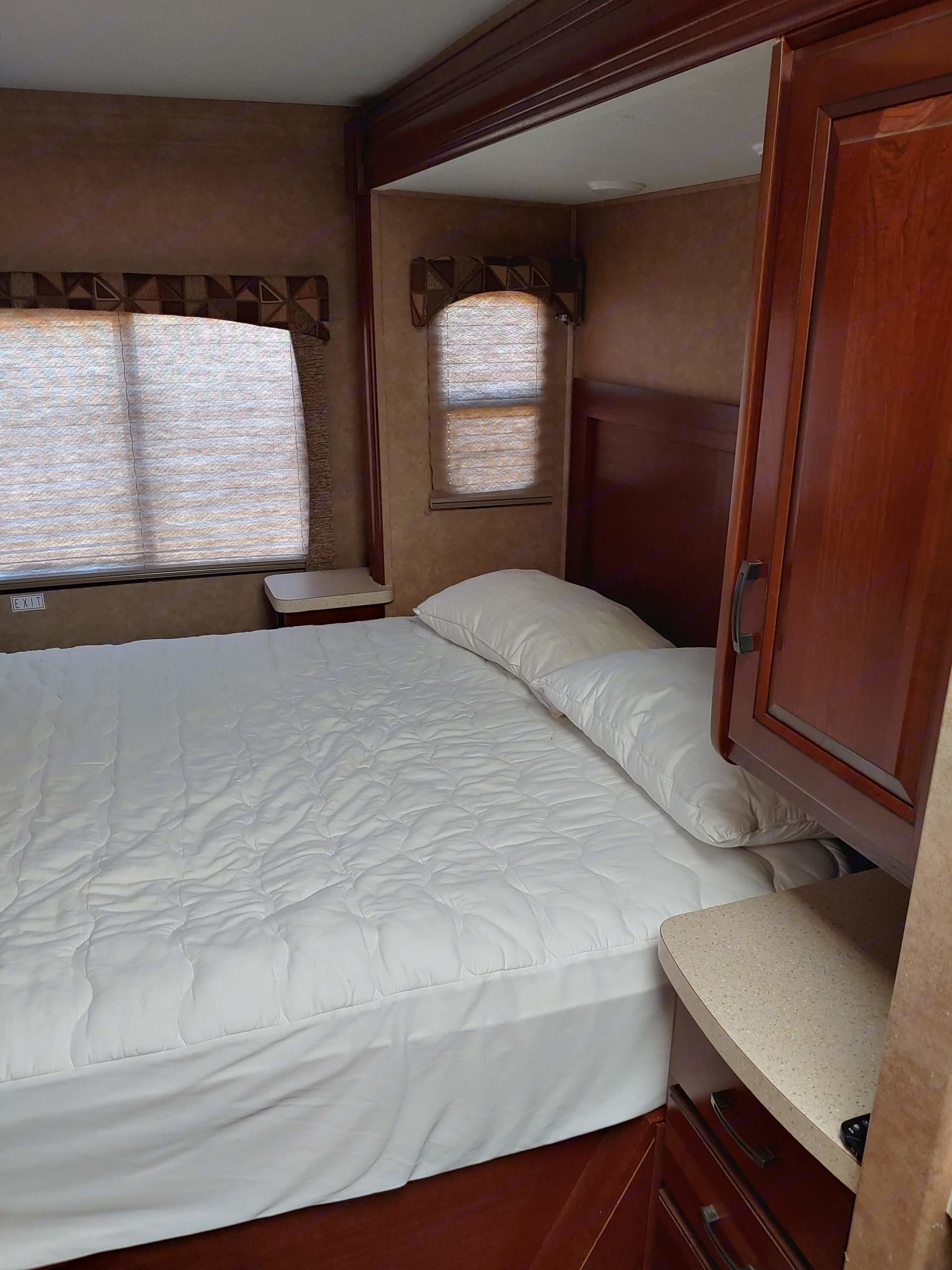 Queen bed in back. Has privacy curtain.. Forest River Sunseeker 2014