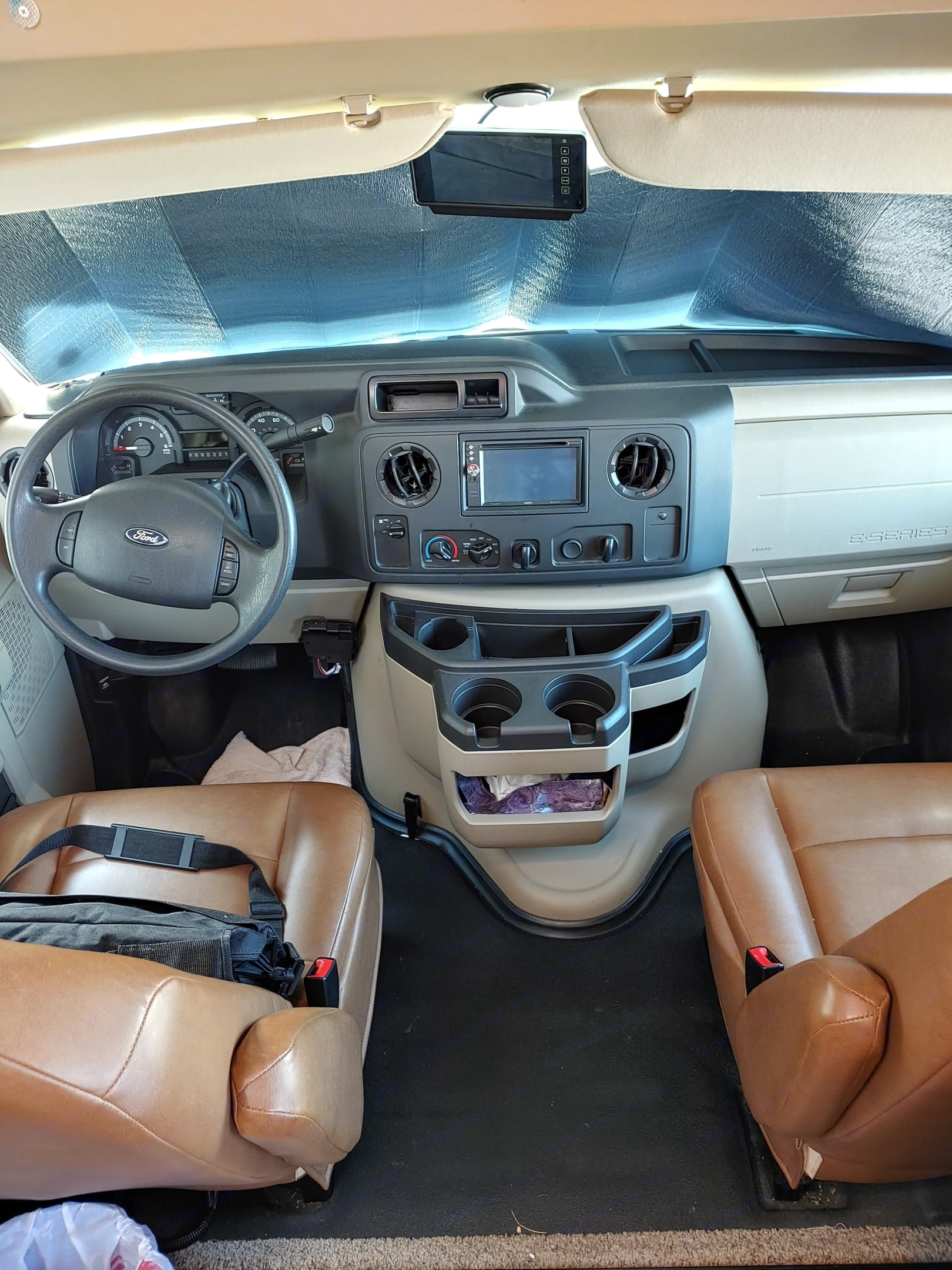 Driver compartment. Has rear camera. Also CD player.. Forest River Sunseeker 2014