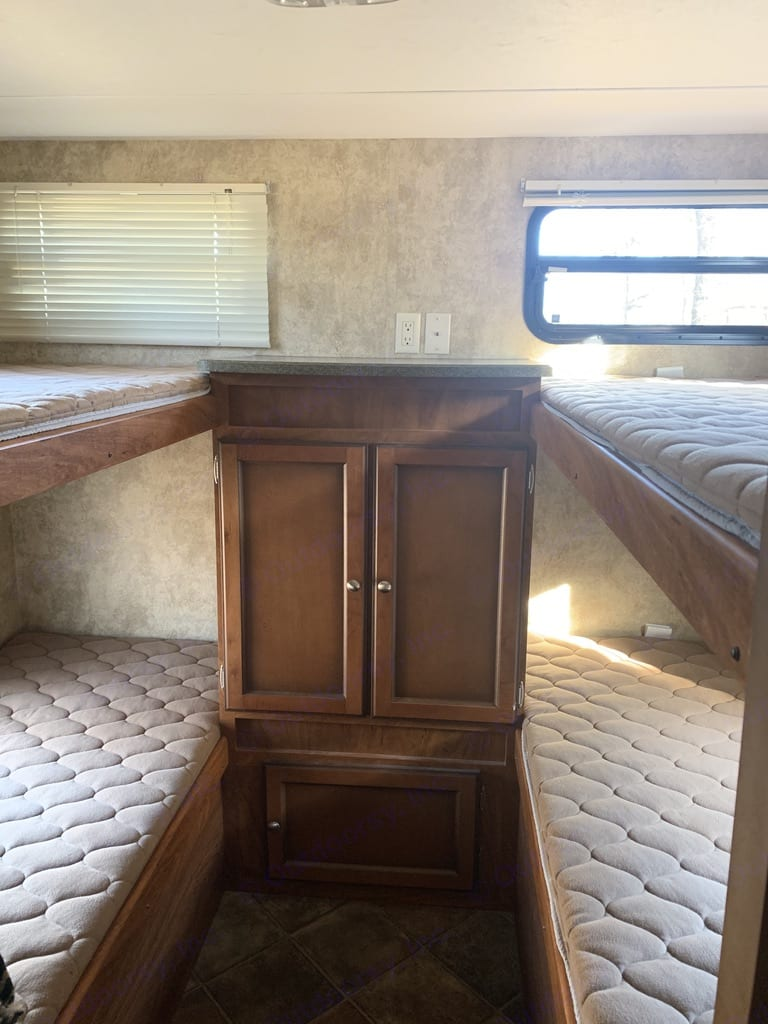 Bunkhouse with 4 single bunk beds.  Bedding is included. Keystone Passport Ultra Lite Grand Touring 2910BH 2012
