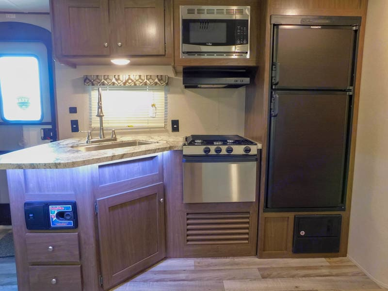 Kitchen is awesome with 3 burner stove as well as microwave and oven.  Large pantry for storage of dry goods or can be used as another closet.. Keystone Hideout 2015