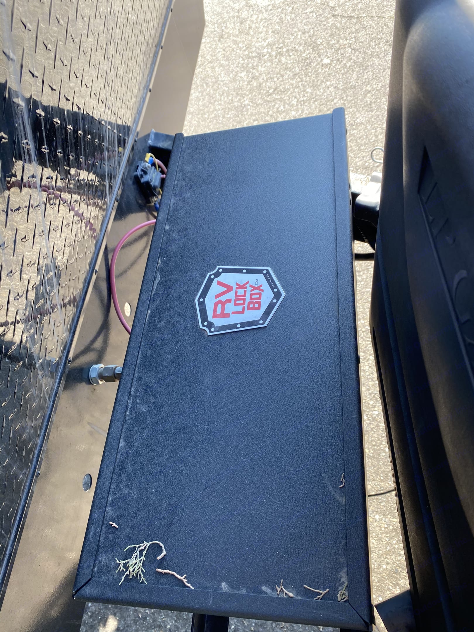 Lock box with two 12 volt batteries. Pacific Coachworks Blaze'N 2018