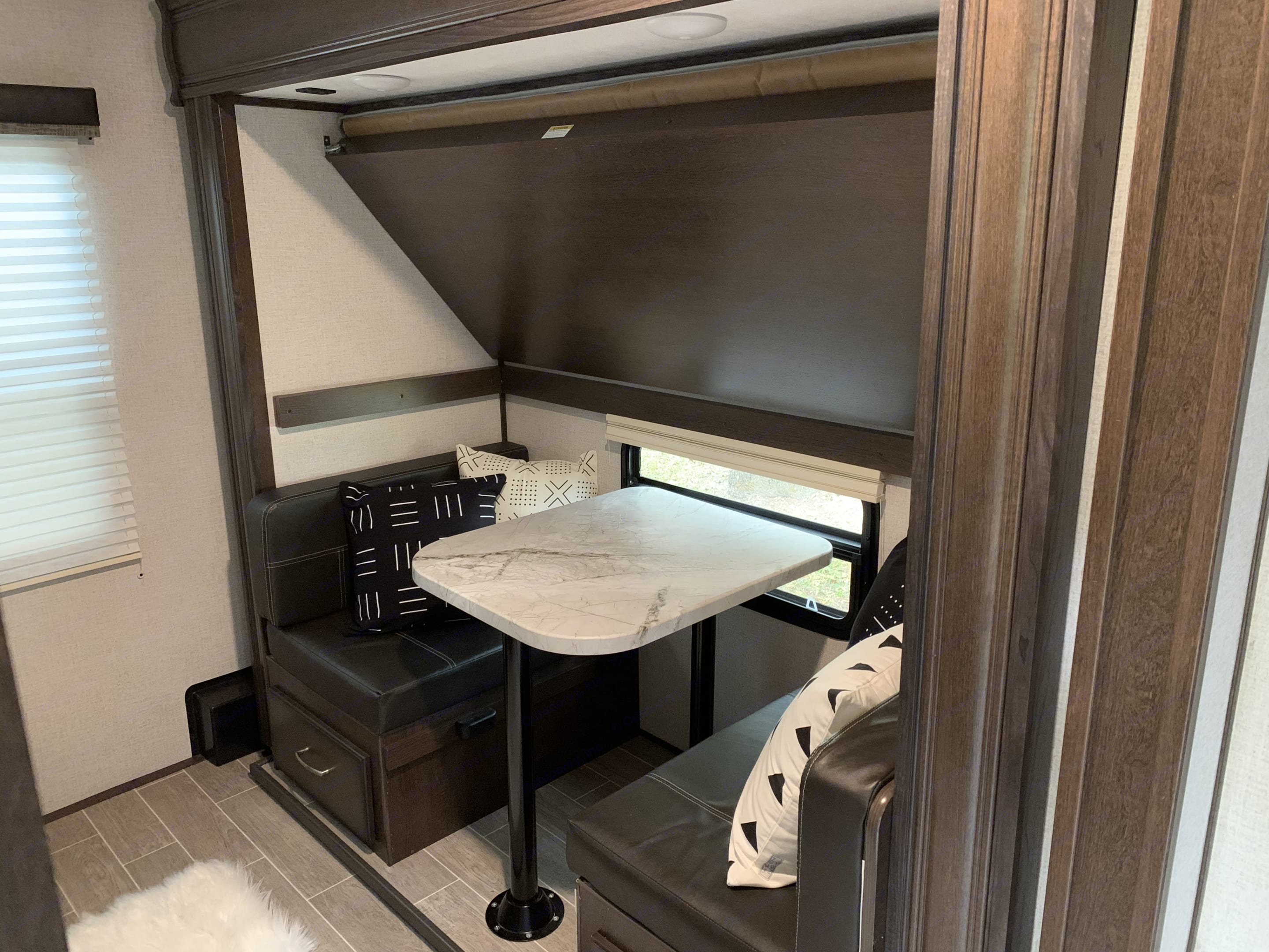 *Bunk Room* Showing Dinette with folded bunk on top. . Dutchmen Atlas 3202BH 2020
