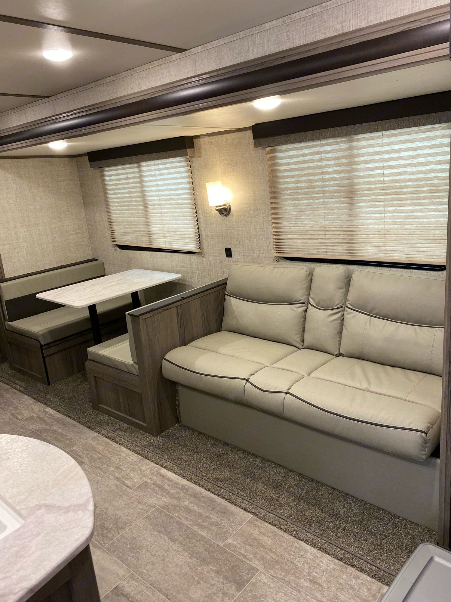 Fold out couch and dinette. Gulf Stream Amerilite 2020