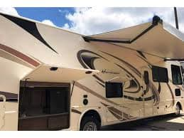 18-foot awning with outdoor kitchen and tv. Thor Motor Coach Hurricane 2018