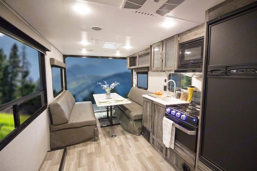 Dining table setup up with large natural light windows.. Forest River Salem 2020