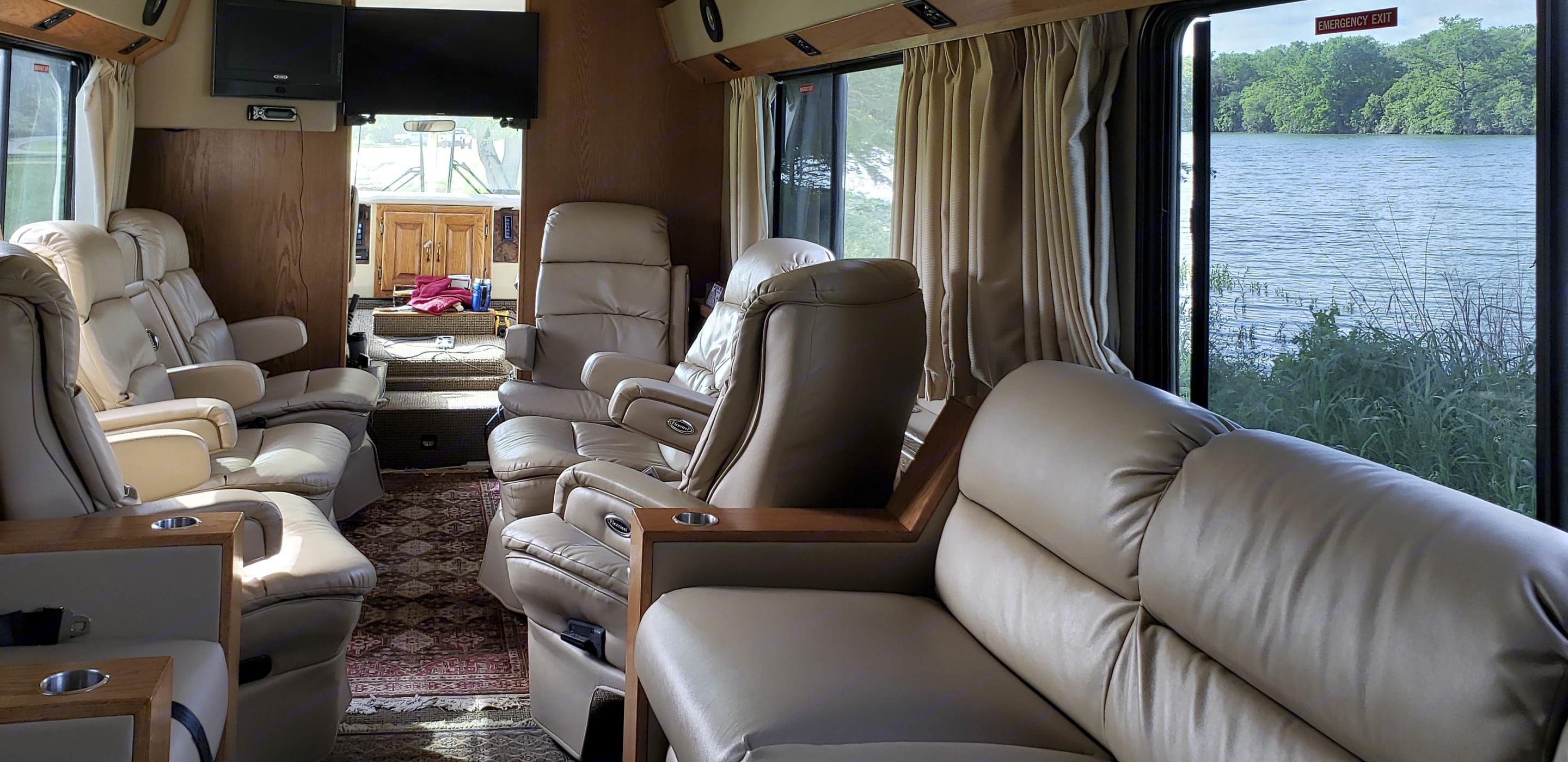 This Airstream Land Yacht was fully customized by Airstream before it ever became an RV. The interior was designed for an executive client who wanted it to resemble the inside of an executive jet. It seats 12 passengers. Has 6 Flexsteel reclining bucket seats, 1 fold out couch, and a 3 theater style seats facing the couch.. Airstream Land Yacht 1999