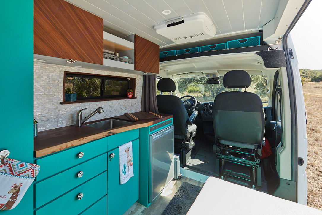 Kitchen w/large refrigerator, deep sink, induction stove top (stored in drawer) and tons of storage.. Dodge Promaster 2500 2019