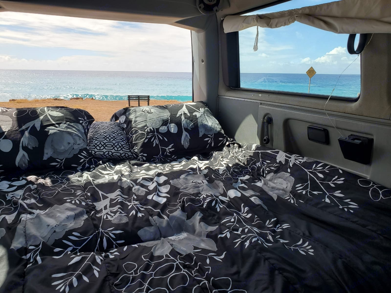 Back seat folds down into a bed.  Bedding, pillows and blankets are supplied. Windows have curtains for privacy.. Volkswagen Vanagon 1989
