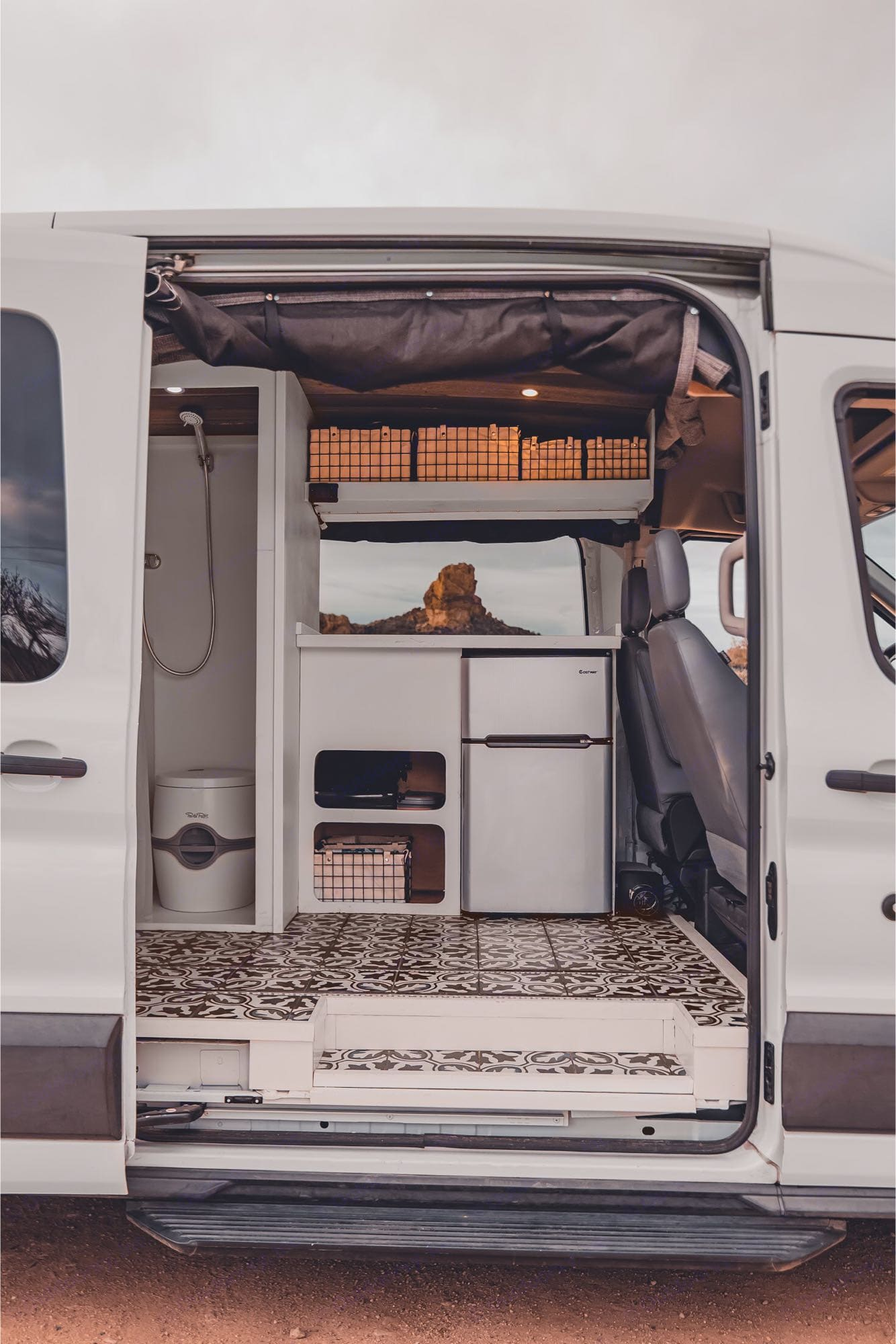 Large windows, refrigerator, and private shower/bathroom. Ford Transit 2015