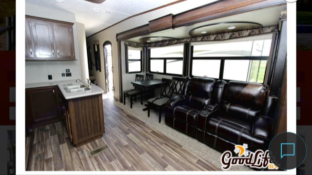 Living room sofa next to dinette that seats up to 4. Keystone Montana High Country 2017