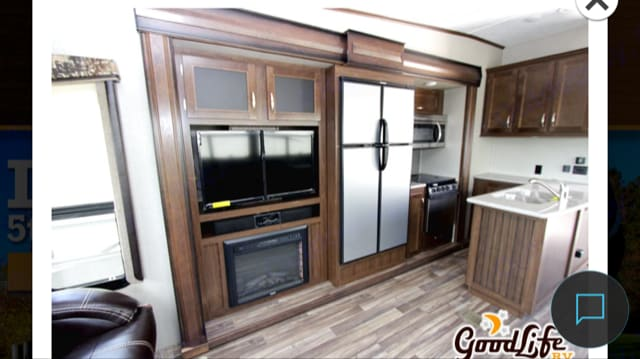 Full refrigerator in kitchen. Keystone Montana High Country 2017