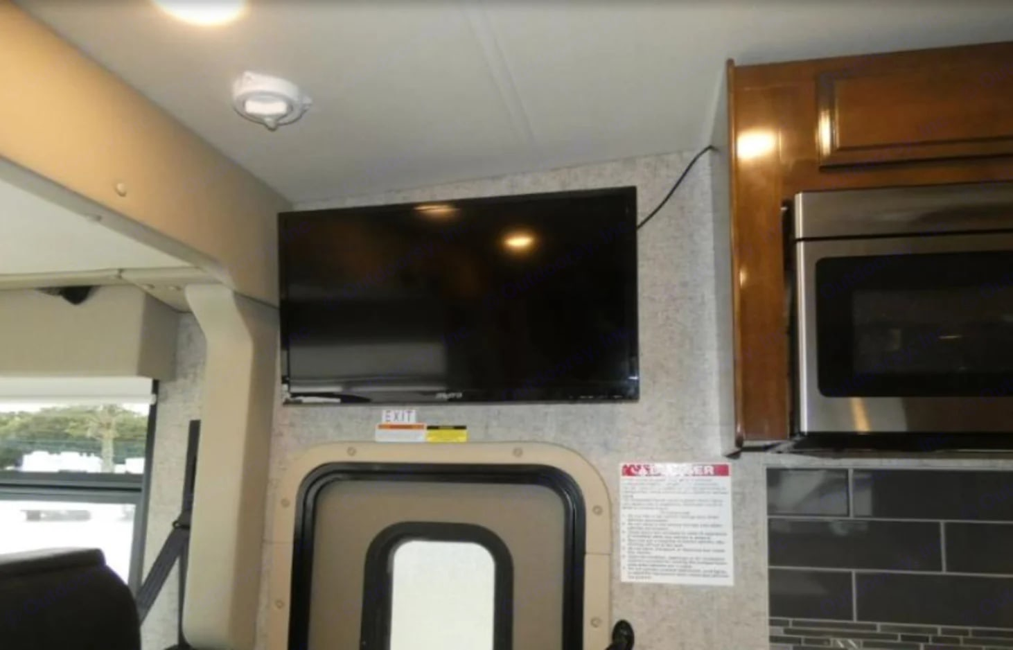 TV in main area. Thor Motor Coach Outlaw 2019