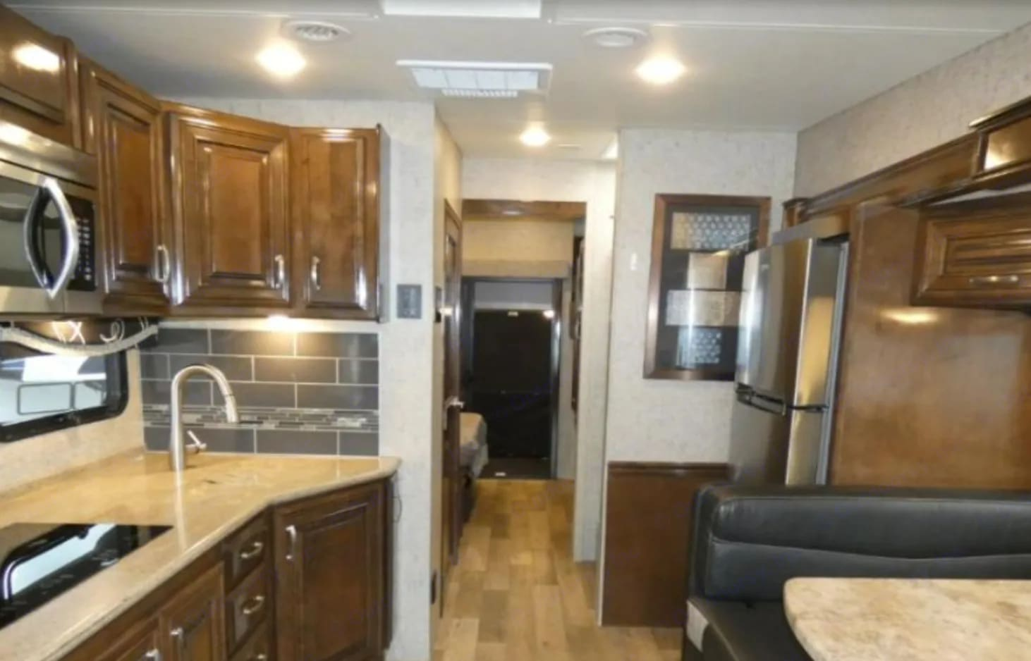 Full kitchen. 2 burners. Microwave convection oven combo.. Thor Motor Coach Outlaw 2019