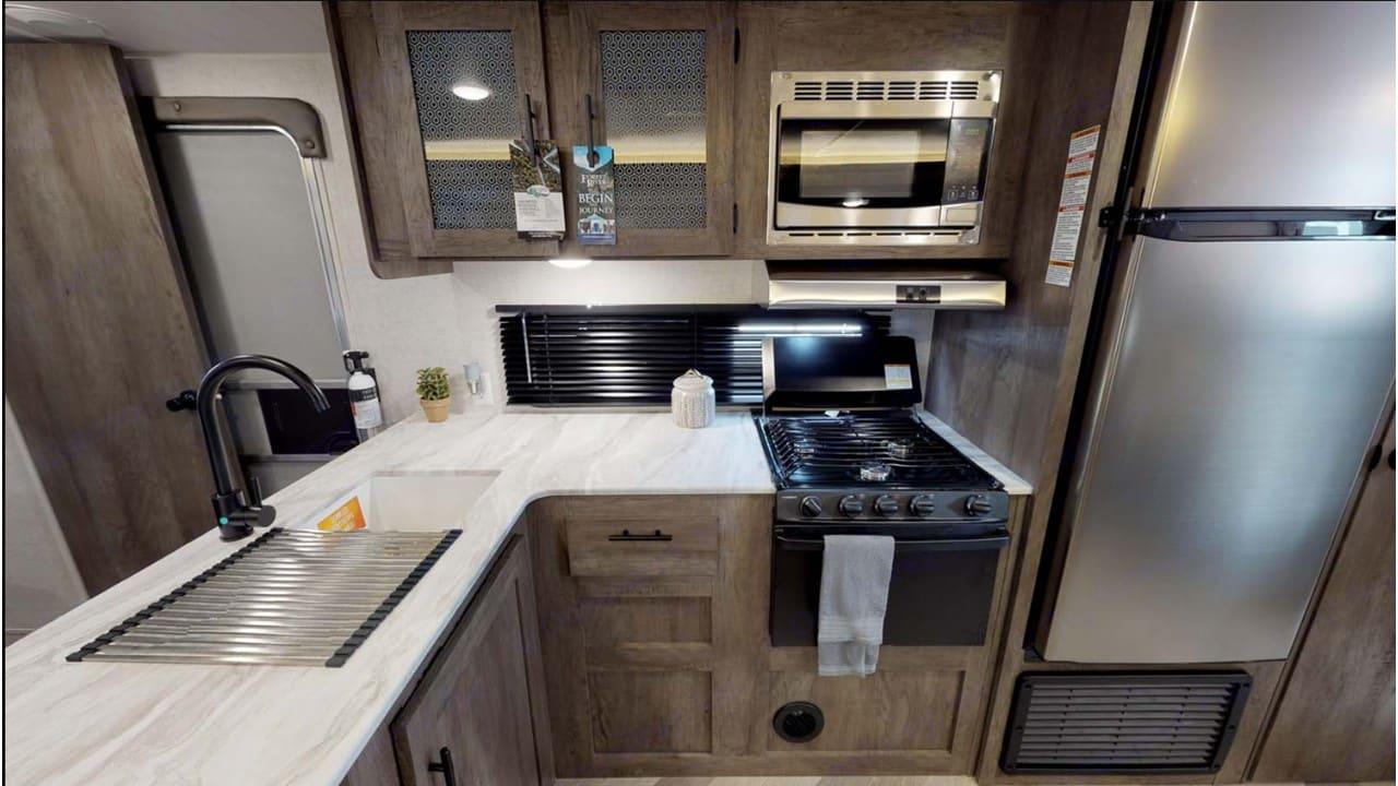 Full Size Sink, 3-burner stove, Oven & Microwave. Forest River Salem Cruise Lite 2020