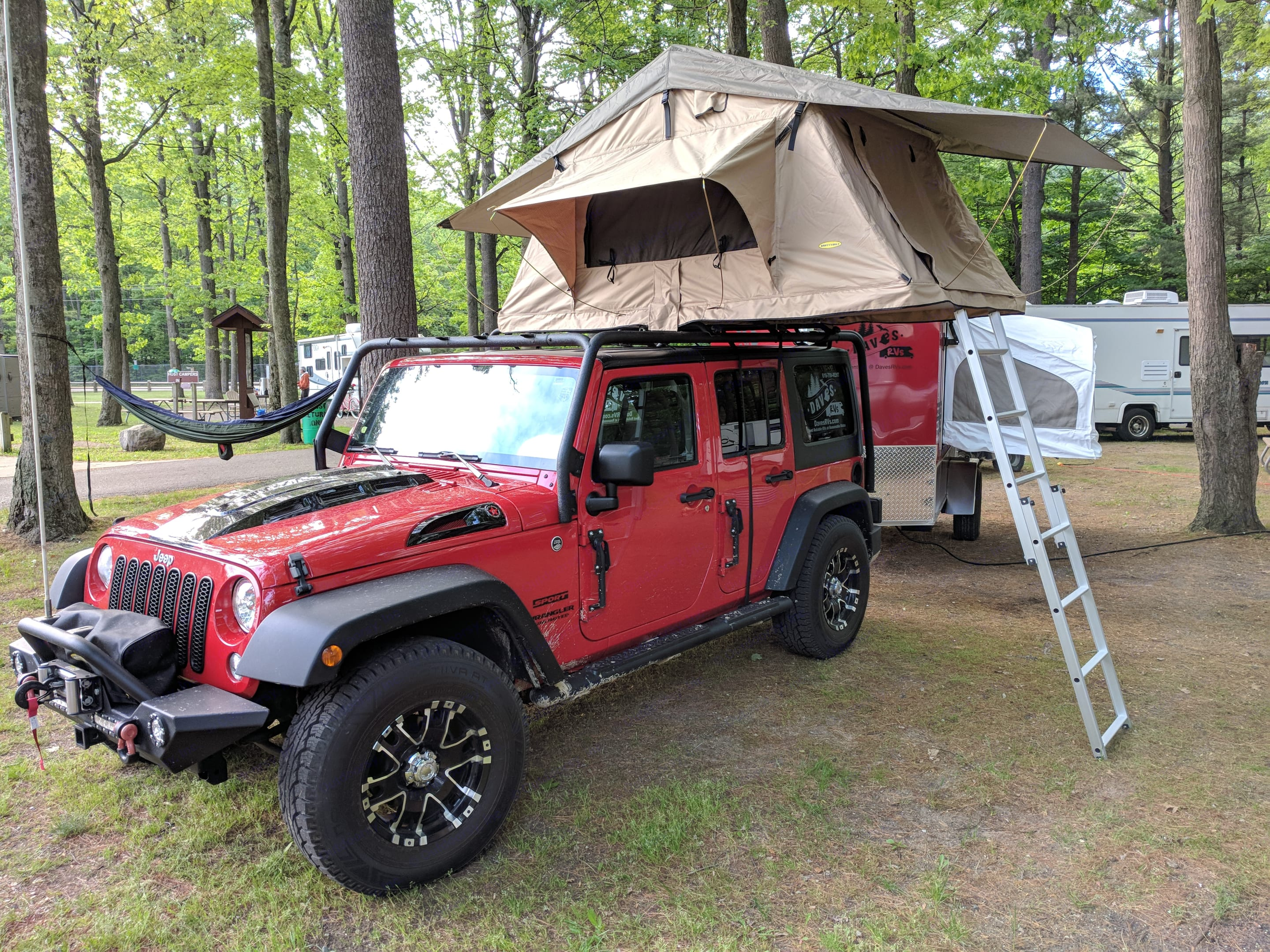 Red with Roof-top tent option. Jeep Wrangler - Sport 2014